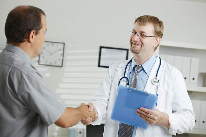 Doctor greating patient
