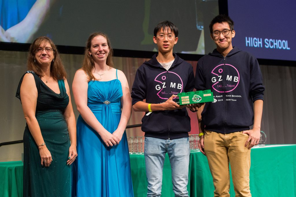 Two members of the TAS Teipei High School team accepting the grand prize for their Genzyme Project (Credit: iGEM Foundation & Justin Knight)