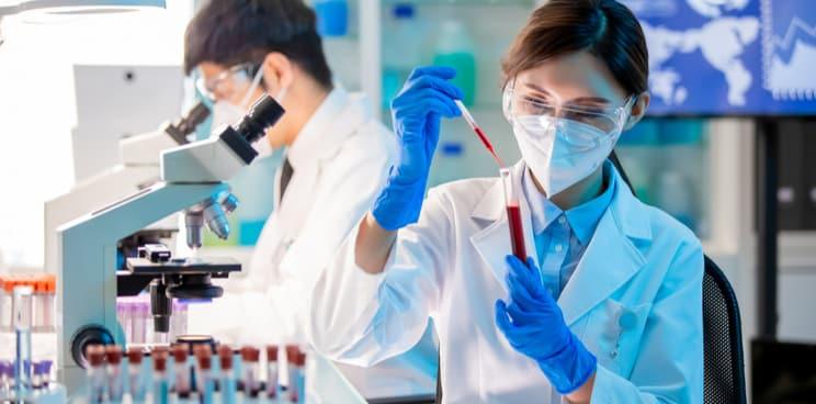 woman in laboratory, microscope, vaccine development