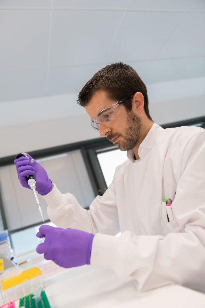 tech transfer, lab work, scientist, researcher, biotech, Merck